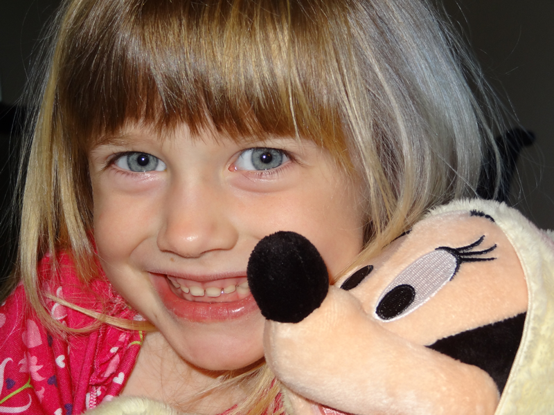 Mia Moore and her Easter Bunny Minnie Mouse doll